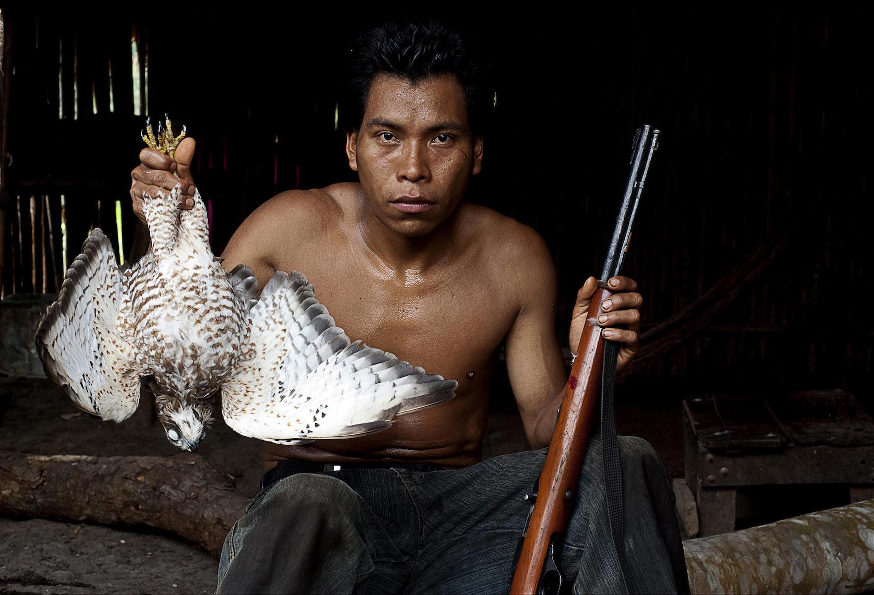 Gilberto with his falcon catch; 2012